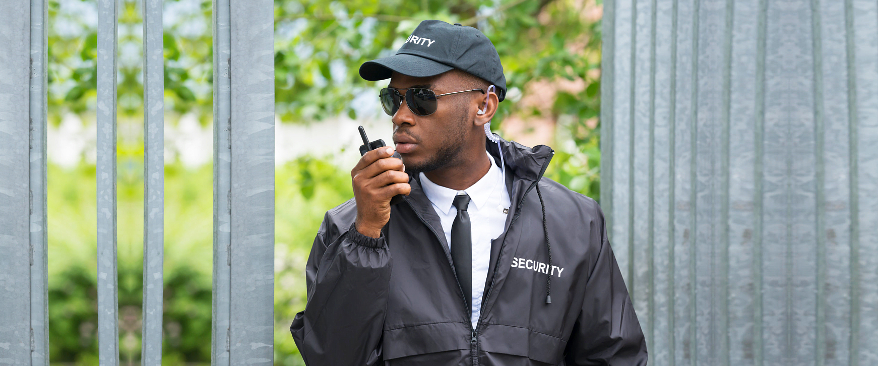 security man holding a walkie talkie