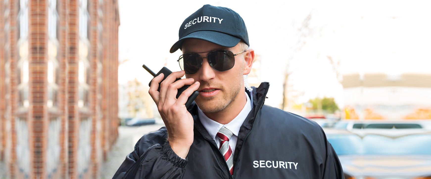 security agent talking using a two-way radio